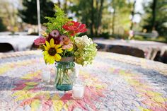 quilts as tablecloths with cute florals
