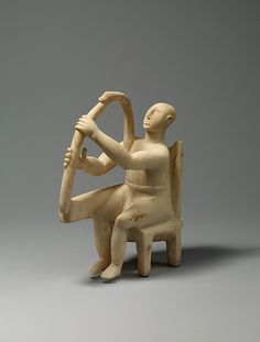 ancientpeoples:  Marble Statue of a Harp Player2800-2700 BC  Late Early Cycladic I–Early Cycladic II    A male figure playing a stringed instrument sits on a high-backed chair. This work is one of the earliest of the small number of known representations of musicians. It is distinguished by the sensitive modelling of the arms and hands.(Source: The Met Museum)