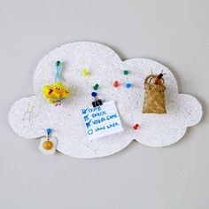 Some of us thought clouds were made of cotton candy. Some of us thought they were made of water vapor. It turns out they're made of cork. But at least it makes them better to attach notes to.<br /><br /><NEWTAG/><h2>Details, details</h2><ul><li> White cloud-shaped corkboard</li><li> Includes double-sided adhesive strips and adhesive magnet strip to hang on a wall or magnetic surface</li><li> Push pins not included</li></ul><h2>Show 'em what you're made of</h2><ul><li> Naturally regenerative…