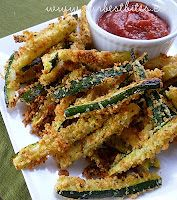 BAKED Zuccini Fries    About 1 lb. zucchini  1/2 c. Italian-seasoned panko bread crumbs  1/4 c. grated Parmesan cheese (the crumbly stuff, not shreds)  2 eggs    425 degrees 10-12 min.