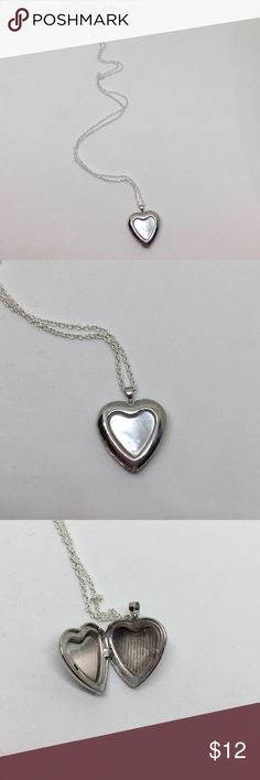 """🆕Vintage Silver & Mother of Pearl Locket A 3/4"""" long Heart-shaped locket with Mother of Pearl on the front. Locket closes nicely and is in perfect working order. Strung on a bright silver necklace marked """"RL"""" at the clasp. All in excellent vintage condition. A lovely keepsake to put another lovely keepsake in... Vintage Jewelry Necklaces"""