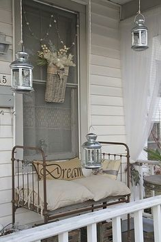 Repurposing Ideas for Outdoor Room Decor - Lots of ideas & tutorials! Including this wonderful porch with antique crib as a garden bench from 'simply southern at heart'.