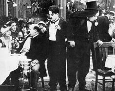 """Charlie and Roscoe """"Fatty"""" Arbuckle in The Rounders (1914)"""