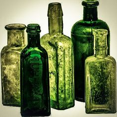 This is another picture that I am not sure I will use in my mood board as the bottles are quiet dirty looking any my collection is very clean and neat, but once again I liked the use of the green colour tones in this and the way they were set. Antique Bottles, Old Bottles, Green Glass Bottles, Slytherin Aesthetic, Hogwarts Mystery, Style Deco, Green Rooms, Colour Board, Green Life