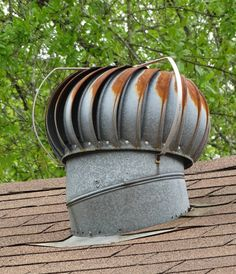 Repurposed Roof Wind Turbine. I'm so going to look for one of these in a flea market / garage sale ! BMM