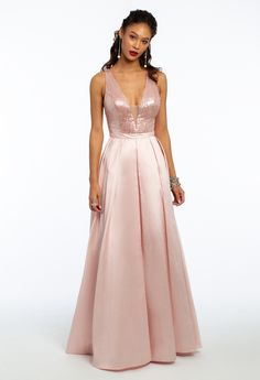 Look pretty and polished in this ladylike ball gown prom dress! From the plunging neckline and fitted bodice with sequin detail, to the mikado ballgown skirt and open back, this halter prom dress shows just enough skin while still keeping it classy and totally chic. Accessorize with metallic heels and a satin bow clutch for a trendy touch. #CamilleLaVie