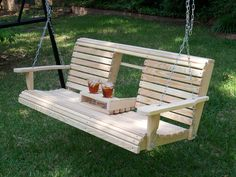 Rounded edge porch swing with clever fold down drink holders. I loved ours out in our backyard. One of my fondest memories is when our Mommy used to make a tent out of it for us...