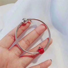Pandora bangle bracelet with red apple charm