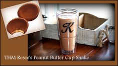 THM Reese's Peanut Butter Cup Shake  3/4 cup unsweetened almond milk 1 scoop unsweetened vanilla whey powder (or plain) 4 tsp. Truvia 3 sprinkles Nunaturals pure white stevia 1Tbsp coconut oil Dash of sea salt 2Tbsp. natural, no sugar creamy peanut butter (we use Adam's) 1Tbsp Cocoa Powder  1/4 c. boiling water (this is to melt the coconut oil. I know, it sounds weird but it works.) ice