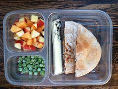 PB&J whole-wheat pitas, mozzarella cheese stick, frozen peas, and a diced apple/cantaloupe mix
