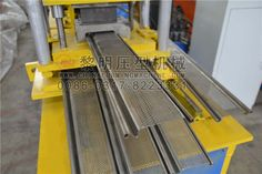 The #Shutter #door #with #hole #roll #forming #machine is consists of decoiler,punch,flattening system,roll forming machine,PLC control system,hydraulic cutting system and run-out table.This production line is very convenient,you just set the correct length ,it's very easy to get you product because this production line is fully automatic.