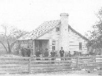 Buckhorn Ranch, of William Pinkney Irwin. Group posed includes, Marvin Irwin (son), Lou Irwin (cousin), William Pinkney Irwin, Minnie Irwin (daughter), J.H. Mitchell (guest), Mary Frances Elmore (Mrs. W.P.) Irwin. Lampasas County, TX, 8 miles north of Lometa Irwin Studio. Western History Collections, University of Oklahoma Libraries, Irwin Brothers Studio Collection, Early Scenes