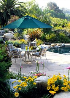 I would love a casual place to hang out on our back patio that had this feel - calm and lush. The pool would be a bonus!