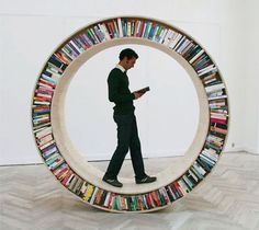 Circular Walking Bookshelf - Cool! Take that traditional face out and compact shelving - Now that's a shelving & display model! Toronto Public Library loans out pedometers free of charge - see here http://www.torontopubliclibrary.ca/detail.jsp?Entt=RDM386958&R=386958