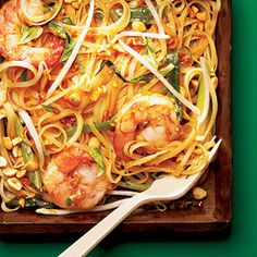 Smother homemade Pad Thai with spicy shrimp, bean sprouts, peanuts and green onion for an Asian dish you will prepare again and again.