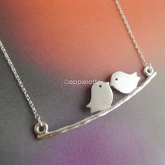 Hey, I found this really awesome Etsy listing at https://www.etsy.com/listing/162123545/love-bird-necklace-in-gold-or-silver
