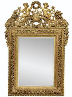 Miroir en bois redoré, travail d'Europe du Nord, vers 1700 A GILTWOOD MIRROR, NORTH EUROPE, CIRCA 1700.
