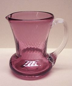 Gorgeous Amethyst  Vintage Hand Blown Art Glass Creamer with Clear Handle. No Chips or Cracks. It is a little difficult to see in the photo but it has a beautiful swirl pattern in the glass. Measures 3 1/2 inches tall.