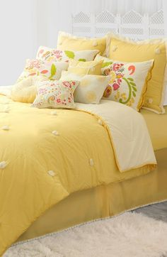 Playful pompoms energize a bright, sunny-hued comforter, by Dena™ Home.