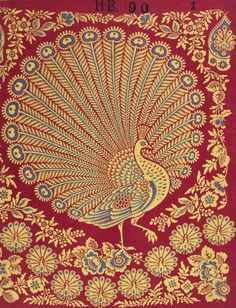 Printed cotton cloth with a blue and yellow peacock in the centre and smaller peacocks and flowers surrounding it.