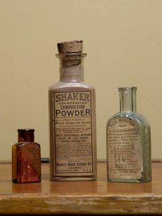 "Three bottles, all with original paper labels, ""Shaker Anodyne, Nth Enfield, NH"", aqua bottle, ""Dose. For an Adult, one teaspoonful in sweetened water,...less for children."", 4"" h; ""The Shaker Family Pills, A.J. White"", red label, amber bottle, ""...Excellent for headache, Colds, Billious Disorders, and Constipation, Price 25 Cents"", 2 1/4"" h; ""Shaker Thompsonian Composition"", ""Powder, Roots, Herbs and Barks...For Grip, Influenza,...Portland, Maine."", 5 1/2"" h."