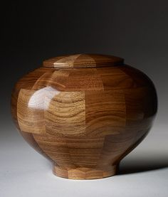 Hand turned in the USA with a lovely collage of Walnut wood panels accenting the naturaly woodgrain. Turned by hand to perfection by an artisan, a gorgeous example of wood memorial art. Cremation Boxes, Cremation Urns, Small Wood Projects, Wood Turning Projects, Wood Router, Wood Lathe, Cnc Router, Funeral Urns, Memorial Urns