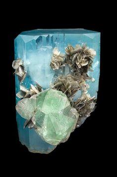 Aquamarine, green fluorite, and silvery muscovite.