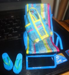 I had this chair in my stash for years, it use to be yellow and had a striped yellow seat. I repainted it, added a new seat and made a beach bag to match.
