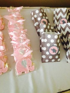Pink and grey elephant party . Treat bags and cookie favors.