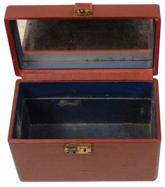 """Bonnie's light brown leatherette cosmetic case, with a slide lock on the side and a mirror inside the cover. According to the Frank Hamer letter of provenance that accompanies the lot, when recovered from the ambush car, the case at the time contained lipstick and a box of Coty face powder and a powder puff, """"about the only feminine touch item in their possession."""""""