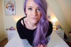 An intense indigo purple hair style with natural waves