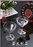 Fancy Party supplies -- plastic stemmed glasses, clear plastic plates, disposable table cloths, etc.