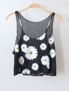 Adorable black crop tank with scoop neckline. Has daisy prints all over the front.  Looks super cute paired with a skater skirt and oversized cardi!