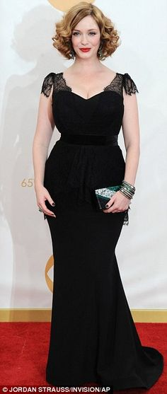 Strutting her stuff: Christina Hendricks showed off her famous curvy figure in a short sleeved lacy black dress, wearing her bright red hair...