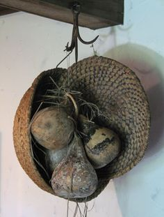Great gathering of prim baskets and  gourds hanging from a unique hook!   Love it!