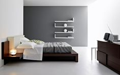 Love the feature wall in this modern minimalist bedroom.