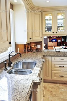 I like this granite with a tile backsplash that color of the wall.