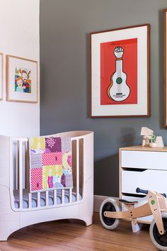 Downstairs front bedroom – Hector's room. Illustrated family portraits on left wall by Emma. Photo - Sean Fennessy. Production – Lucy Feagins / The Design Files.