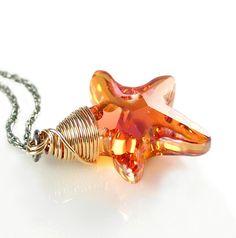 Sun Kissed Starfish Necklace 14K Gold Fill Sterling Silver Swarovski Orange Blush Crystal Starfish Necklace. $34.00, via Etsy.