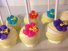 Yellow Swirled Cake Pops with Pink, Turquoise, Orange & Purple Hibiscus Flowers