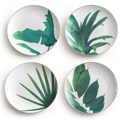 "The Rosanna Jet Setter Botanical plate set delivers natural inspiration to tabletops. Rimmed in gold, these white dishes showcase a tropical leaf design in emerald green. Set of 12; Porcelain with gold accents; Arrives packaged in a gift box; Hand wash only; Do not microwave; 8"" Dia"