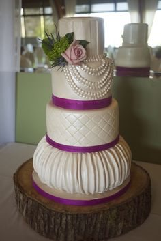 This cake has a lot of features I want on my cake. The quilted texture with the little pearls in the middle of the diamond lines. The bottom tier, but I'd like it to flow out instead of under. I like this cake as a whole