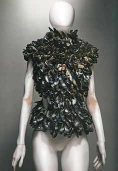 Alexander McQueen Savage Beauty - made entirely out of mussel shells. I have touched mussel shells, but my brain is still telling me this feels good.
