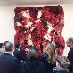 Lisson staff getting a closer look at Anish Kapoor's new work pre-opening.