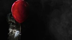 Clown holding a red balloon