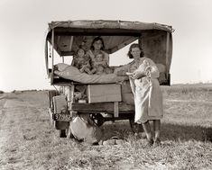 "August 1936. Family between Dallas and Austin, Texas. The people have left their home and connections in South Texas, and hope to reach the Arkansas Delta for work in the cotton fields. Penniless people. No food and three gallons of gas in the tank. The father is trying to repair a tire. Three children. Father says, ""It's tough but life's tough anyway you take it."""