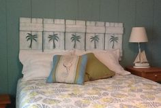 Shorter palm tree shutters by CastawaysHall hung in a row for an instant headboard.