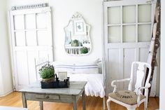 French country style. Vintage doors become look fabulous leaning against this wall.