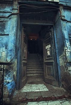 Beckoning open doors in abandoned places...hmmmmm what might be in there?
