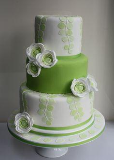 Fresh contemporary cake with beautiful ranunculus flowers. www.choosecake.co.uk
